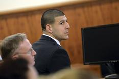 Former New England Patriots football player Aaron Hernandez appears in the court room of the Bristol County Superior Court House in Fall River, Massachusetts, in front of the jury before they begin their deliberations, April 8, 2015.  REUTERS/Faith Ninivaggi