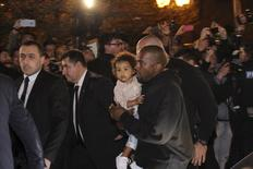 Rapper Kanye West carries his daughter North shortly upon their arrival together with TV celebrity Kim Kardashian in Yerevan, April 8, 2015.  REUTERS/Samvel Berkibekyan/PAN Photo