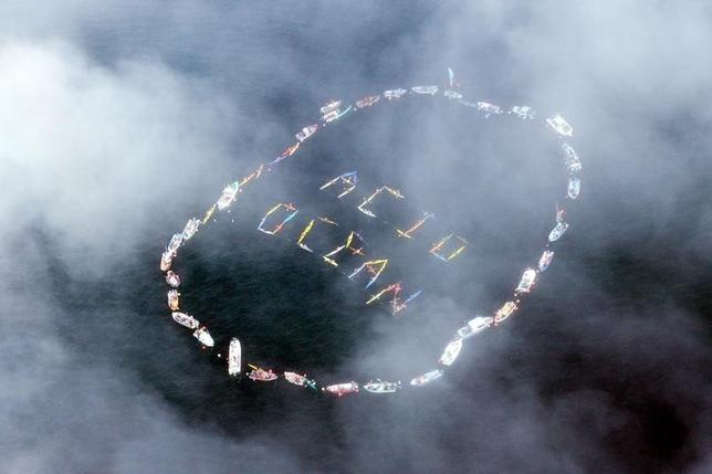 Commercial fishermen and other mariners form the words ''Acid Ocean'' during an event held to spread the message of saving the oceans from acidification caused by fossil fuel emissions, in Homer, Alaska, in this file photo taken on September 6, 2009. REUTERS/Lou Dematteis