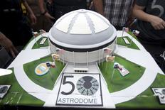 The Dome cake, baked by Bethany Berend, 35, is seen before it is served as people celebrate the 50th anniversary of the Astrodome stadium in Houston, Texas, April 9, 2015. REUTERS/Daniel Kramer