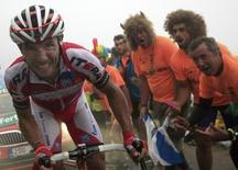 Spain's Joaquim Rodriguez is cheered by supporters as he climbs L'Angliru port during the 142-km 20th stage of the Vuelta, Tour of Spain cycling race from Aviles to Alto de L'Angliru September 14, 2014.  REUTERS/Joseba Etxaburu