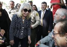 Shelly Sterling, 79, (L) smiles with Donald Sterling's lawyer Max Blecher (R) after leaving court in Los Angeles, California July 28, 2014.  REUTERS/Lucy Nicholson