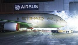 An Airbus A380 rolls out of a paint hangar during a branding ceremony of Etihad Airways, the national airline of the United Arab Emirates (UAE), at the German headquarters of aircraft company Airbus, in Hamburg-Finkenwerder September 25, 2014.  REUTERS/Fabian Bimmer