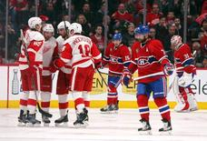 Detroit Red Wings center Darren Helm (43) celebrates his goal against Montreal Canadiens goalie Carey Price (31) with teammates during the third period at Bell Centre. Mandatory Credit: Jean-Yves Ahern-USA TODAY Sports