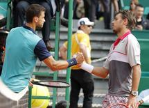 Grigor Dimitrov of Bulgaria (L) shakes hands with Stan Wawrinka of Switzerland after winning their match at the Monte Carlo Masters in Monaco April 16, 2015.  REUTERS/Eric Gaillard