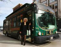 Crystal Hill, a Cleveland regional Transit Authority Trolley driver poses outside her trolley as Tina Turner as part of the Rock and Roll Hall of Fame Induction week in Cleveland, Ohio April 15, 2015.  REUTERS/Aaron Josefczyk
