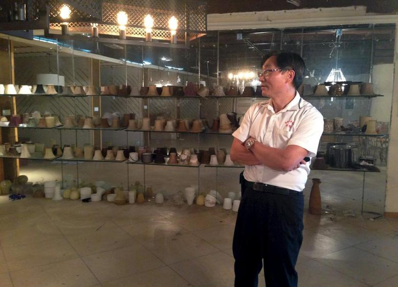 Johnny Tsai, Pascal's general manager, stands inside Pascal Lighting in Huizhou, Guangdong province, April 13, 2015. REUTERS/Alexandra Harney