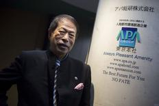 APA Group CEO Motoya Toshio poses for pictures after an interview at the hotel group's headquarters in Tokyo April 17, 2015.   REUTERS/Thomas Peter