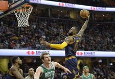 Cleveland Cavaliers forward LeBron James (23) drives to the basket in the third quarter against the Boston Celtics at Quicken Loans Arena. Mandatory Credit: David Richard-USA TODAY Sports