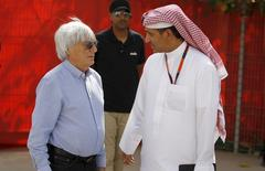 Formula One supremo Bernie Ecclestone (L) speaks with Cheif Executive Officer of the Bahrain International Circuit, Sheikh Salman bin Isa Al Khalifa, as he arrives ahead of Bahrain's F1 Grand Prix at Bahrain International Circuit south of Manama, April 16, 2015. REUTERS/Hamad I Mohammed