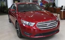 A  2015 red Ford Taurus sedan is seen in the showroom at the Suburban Ford dealership in Sterling Heights, Michigan, February 6, 2015.   REUTERS/Rebecca Cook