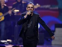 "Ringo Starr, drummer for The Beatles, performs during the taping of ""The Night That Changed America: A Grammy Salute To The Beatles"", which commemorates the 50th anniversary of The Beatles appearance on the Ed Sullivan Show, in Los Angeles January 27, 2014.   REUTERS/Mario Anzuoni"