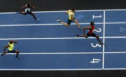 "Jamaican Olympic gold medallist Usain Bolt (3) runs against Jose Carlos Moreira of Brazil (1), Ryan Bailey of the U.S. (2) and Churandy Martina (4) of the Netherlands in the ""Mano a Mano"" challenge, a 100-meter race in Rio de Janeiro April 19, 2015. REUTERS/Ricardo Moraes"