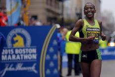 Caroline Rotich of Kenya crosses the finish line to win the women's division of the 119th Boston Marathon in Boston, Massachusetts April 20, 2015.  REUTERS/Brian Snyder