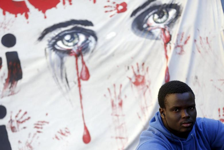 A migrant looks on during a protest in front of the Italian Chamber of Deputies in Rome, April 21, 2015. REUTERS/Yara Nardi