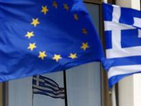 Greek and EU flags are seen outside the Foreign Ministry in Athens March 12, 2015. REUTERS/Yannis Behrakis