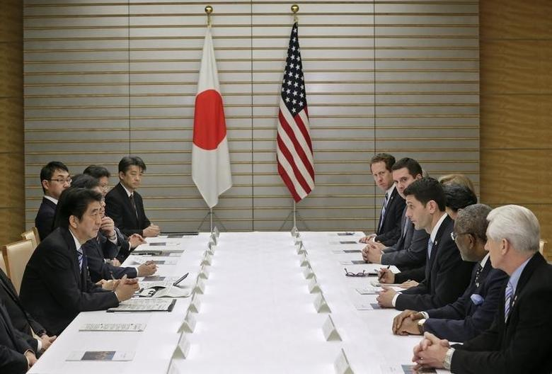 U.S. House of Representatives Ways and Means Committee Chairman Paul Ryan (3rd R), leading a congressional delegation, talks with Japan's Prime Minister Shinzo Abe (L) on Trans-Pacific Partnership (TPP) and other issues at Abe's official residence in Tokyo February 19, 2015. REUTERS/Kimimasa Mayama/Pool
