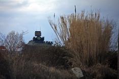 Зенитная батарея в Сочи. 6 февраля 2014 года. США обвинили Россию в строительстве системы ПВО на востоке Украины и участии в обучении пророссийских повстанцев в нарушение минских соглашений, достигнутых при посредничестве ЕС. REUTERS/Eric Gaillard