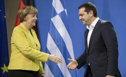 German Chancellor Angela Merkel and Greek Prime Minister Alexis Tsipras go to shake hands after addressing a news conference at the Chancellery in Berlin March 23, 2015.  REUTERS/Hannibal Hanschke