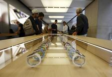 Apple Watches are pictured under a glass display table at the company's flagship store in Sydney April 24, 2015.  REUTERS/Jason Reed