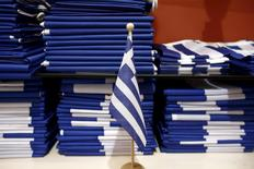 Greek national flags sit arranged for sale at a shop in Athens, April 23, 2015. REUTERS/Kostas Tsironis