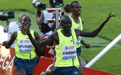Ronald Kwemoi of Kenya reacts as he crosses the finish line in the men's 1500m race during the Lausanne Diamond League meeting at the Stade de la Pontaise in Lausanne July 3, 2014.    REUTERS/Pierre Albouy
