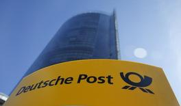 A Deutche Post sign stands in front of the Bonn Post Tower, the headquarters of German postal and logistics group Deutsche Post DHL in Bonn March 11, 2015.         REUTERS/Wolfgang Rattay