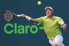 Kei Nishikori reaches for a forehand against John Isner (not pictured) in a men's singles quarter-final on day eleven of the Miami Open at Crandon Park Tennis Center. Isner won 6-4, 6-3. Mandatory Credit: Geoff Burke-USA TODAY Sports