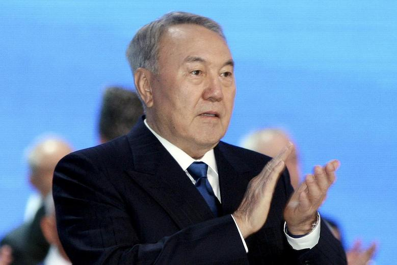 Kazakhstan's President and presidential candidate Nursultan Nazarbayev applauds as he attends a session of the Assembly of People of Kazakhstan in Astana April 23, 2015. REUTERS/Mukhtar Kholdorbekov