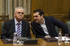 Greek Prime Minister Alexis Tsipras (R) talks to Deputy Prime Minister Yannis Dragasakis during the first meeting of new cabinet post elections in the parliament building in Athens January 28, 2015. REUTERS/Marko Djurica