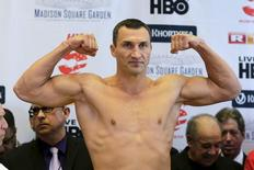 Reigning heavyweight champion Wladimir Klitschko of Ukraine clenches his fists during an official weigh-in ahead of his fight in New York April 24, 2015.  REUTERS/Eduardo Munoz