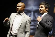 "Eleven-time, five-division world boxing champion Floyd ""Money"" Mayweather (L) and eight-division world champion Manny ""Pac-Man"" Pacquiao pose at a news conference ahead of their upcoming bout, in Los Angeles, California March 11, 2015.  REUTERS/Lucy Nicholson"