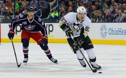 Pittsburgh Penguins center Sidney Crosby (87) carries the puck as Columbus Blue Jackets center Alexander Wennberg (41) trails the play during the first period at Nationwide Arena. Mandatory Credit: Russell LaBounty-USA TODAY Sports