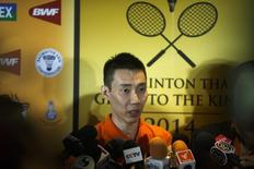 Malaysia's Lee Chong Wei speaks to media during a news conference in Bangkok November 21, 2014.  REUTERS/Athit Perawongmetha