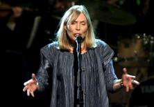 Musician Joni Mitchell performs during the filming of a television tribute to her in New York, in this file photo taken April 6, 2000.  REUTERS/Stringer/Files