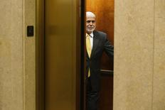 An elevator door closes on outgoing U.S. Federal Reserve Chairman Ben Bernanke as he leaves his office for the last time before his retirement, at the U.S. Federal Reserve in Washington, January 31 2014.  REUTERS/Jonathan Ernst