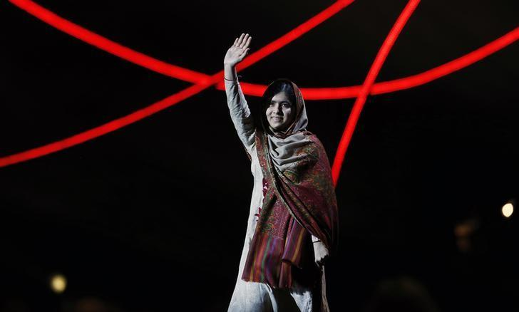 Nobel Peace Prize laureate Malala Yousafzai waves as she arrives on stage at the Nobel Peace Prize Concert in Oslo December 11, 2014. REUTERS/Suzanne Plunkett