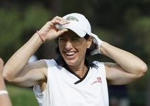 Juli Inkster of the U.S. adjusts her cap on the 13th tee during practice for the U.S. Women's Open golf tournament at The Broadmoor in Colorado Springs, Colorado July 6, 2011. REUTERS/Rick Wilking