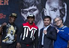 Undefeated WBC/WBA welterweight champion Floyd Mayweather Jr. (2nd L) of the U.S. and WBO welterweight champion Manny Pacquiao (2nd R) of the Philippines pose with trainers Floyd Mayweather Sr. (L) and Freddie Roach during a final news conference at the MGM Grand Arena in Las Vegas, Nevada April 29, 2015. REUTERS/Las Vegas Sun/Steve Marcus