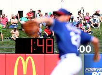 Detailed view of the pace of play digital pitch clock in the outfield between innings of the game between the Texas Rangers against the San Francisco Giants during a spring training baseball game at Surprise Stadium in Surprise, Arizona, in this March 6, 2015, file photo. Mandatory Credit: Mark J. Rebilas-USA TODAY Sports