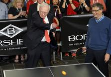 Berkshire Hathaway CEO Warren Buffett (L) plays table tennis with Microsoft co-founder Bill Gates during the Berkshire annual meeting weekend in Omaha, Nebraska May 3, 2015. REUTERS/Rick Wilking