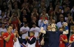 Davis Cup World Group First Round - Emirates Arena, Glasgow, Scotland - 8/3/15. Great Britain's Andy Murray celebrates victory over USA's John Isner (not pictured) to win the tie as Great Britain captain Leon Smith (L) applauds Action Images via Reuters / Andrew Boyers Livepic