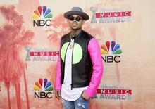 Singer Chris Brown poses at the 2015 iHeartRadio Music Awards in Los Angeles, California, March 29, 2015. REUTERS/Danny Moloshok