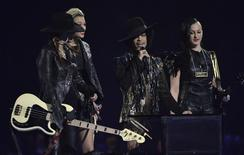 Prince and his band 3rdEyeGirl present the award for British Female Solo Artist at the BRIT Awards, celebrating British pop music, at the O2 Arena in London February 19, 2014. REUTERS/Toby Melville