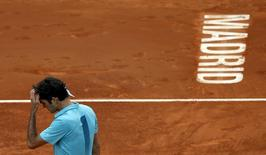 Roger Federer of Switzerland reacts during his match against Nick Kyrgios of Australia at the Madrid Open tennis tournament in Madrid, Spain, May 6, 2015. REUTERS/Susana Vera