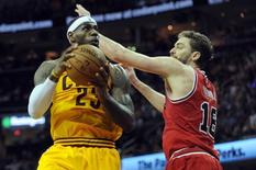 May 6, 2015; Cleveland, OH, USA; Cleveland Cavaliers forward LeBron James (23) shoots on Chicago Bulls forward Pau Gasol (16) during the third quarter in game two of the second round of the NBA Playoffs at Quicken Loans Arena. Mandatory Credit: Ken Blaze-USA TODAY Sports