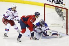 May 6, 2015; Washington, DC, USA; Washington Capitals left wing Andre Burakovsky (65) scores a goal on New York Rangers goalie Henrik Lundqvist (30) as Rangers defenseman Ryan McDonagh (27) defends in the third period in game four of the second round of the 2015 Stanley Cup Playoffs at Verizon Center. The Capitals won 2-1, and lead the series 3-1. Mandatory Credit: Geoff Burke-USA TODAY Sports