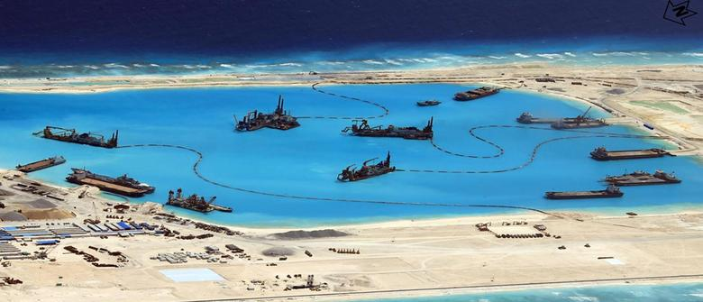 A handout picture released by the Armed Forces of the Philippines (AFP) shows an image of the structures being built by China at the disputed islands during a news conference at the AFP headquarters in Manila April 20, 2015.  REUTERS/Armed Forces of the Philippines/Handout via Reuters