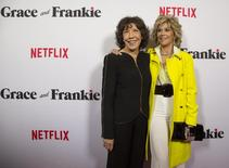 "Cast members Lily Tomlin (L) and Jane Fonda pose at the premiere for the Netflix original series ""Grace and Frankie"" at Regal theatre in Los Angeles, California in this April 29, 2015, file photo.  REUTERS/Mario Anzuoni/Files"