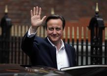 Britain's Prime Minister David Cameron waves as he leaves the Conservative Party headquarters in London, Britain May 8, 2015. REUTERS/Peter Nicholls